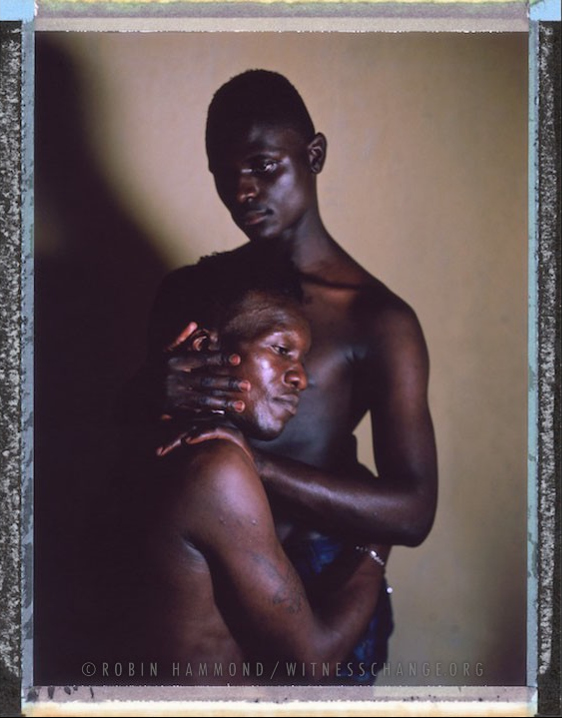 "A posed posed portrait of 20 year old Rihana (standing, not his real name), with his friend and room mate Kim, 25. In early 2014 they were evicted by their landlord and severely beaten by the local community. The police intervened and both were arrested and charged with 'Homosexuality'. They spent seven months in prison awaiting trial ""we were taken to prison and we had hard life e.g. we were beaten, forced to do hard work"" says Rihana. They complain that they are continuously harassed by the police. Uganda. Uganda, September 2014.  While many countries around the world are legally recognizing same-sex relationships, individuals in nearly 80 countries face criminal sanctions for private consensual relations with another adult of the same sex. Violence and discrimination based on sexual orientation or gender expression is even more widespread. Africa is becoming the worst continent for Lesbian, Gay, Bi-sexual, Transgender, Queer, Inter-sex (LGBTQI) individuals. More than two thirds of African countries have laws criminalizing consensual same-sex acts. In some, homosexuality is punishable by death. In Nigeria new homophobic laws introduced in 2013 led to dramatic increase in attacks. Under Sharia Law, homosexuality is punishable by death, up to 50 lashes and six months in prison for woman; for men elsewhere, up to 14 years in prison. Same sex acts are illegal in Uganda. A discriminatory law was passed then struck down and homophobic attacks rose tenfold after the passage of the Anti-Homosexuality Act. In Cameroon it is also illegal. More cases against suspected homosexuals are brought here than any other African country. In stark contrast with the rest of the continent, same sex relationships are legal in South Africa. The country has the most liberal laws toward gays and lesbians on the continent, with a constitution guaranteeing LBGTQI rights. Because of this, LGBTQI Africans from all over the continent fleeing persecution have come to South Africa. Despite these laws, many lesbians have been victims of 'corrective rape' and homosexuals have been murdered for their sexuality. Homophobia is by no means just an African problem. In Russia, politicians spread intolerance. In June 2013 the country passed a law making ""propaganda"" about ""non-traditional sexual relationships"" a crime. Attacks against gays rose. Videos of gay men being tortured have been posted online. In predominantly Muslim Malaysia, law currently provides for whipping and up to a 20-year prison sentence for homosexual acts involving either men or women. Increased extreme Islamification in the Middle East is making life more dangerous for gay men there, as evidenced by ISIS's recent murders of homosexual men. While homophobic discrimination is widespread in Lebanon, life is much safer there than Iran, Iraq, and Syria from which refugees are fleeing due to homophobic persecution. Photo Robin Hammond/Panos for Witness Change"