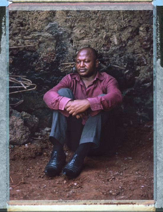 "A posed portrait of 41 year old Marc Lambert Lamba. In May 2005 Marc was arrested at a bar in Cameroon's capital Yaounde along with nearly 40 others. Many were able to bribe their way out of the police station, the remaining 11, of which Lambert was one, were put in prison. They spent 12 months awaiting trial. In the end seven of the 11 were charged with the crime of homosexuality and sentenced to seven months in prison. They had already served their time awaiting trial so were released. Lambert says,  ""it was a nightmare for me but I transformed this nightmare into an opportunity – it gave me the chance to denounce to the international community the situation of discrimination against people in my country for their sexual orientation or gender identity. Thanks to that a LGBT movement was born in Cameroon"". Lambert took the Cameroonian Government to the Working Group on Arbitrary Detention at The United Nations and won his case. The Cameroonian Government ignored the verdict. Yaounde, Cameroon. December 2014.  While many countries around the world are legally recognizing same-sex relationships, individuals in nearly 80 countries face criminal sanctions for private consensual relations with another adult of the same sex. Violence and discrimination based on sexual orientation or gender expression is even more widespread. Africa is becoming the worst continent for Lesbian, Gay, Bi-sexual, Transgender, Queer, Inter-sex (LGBTQI) individuals. More than two thirds of African countries have laws criminalizing consensual same-sex acts. In some, homosexuality is punishable by death. In Nigeria new homophobic laws introduced in 2013 led to dramatic increase in attacks. Under Sharia Law, homosexuality is punishable by death, up to 50 lashes and six months in prison for woman; for men elsewhere, up to 14 years in prison. Same sex acts are illegal in Uganda. A discriminatory law was passed then struck down and homophobic attacks rose tenfold after the passage of the Anti-Homosexuality Act. In Cameroon it is also illegal. More cases against suspected homosexuals are brought here than any other African country. In stark contrast with the rest of the continent, same sex relationships are legal in South Africa. The country has the most liberal laws toward gays and lesbians on the continent, with a constitution guaranteeing LBGTQI rights. Because of this, LGBTQI Africans from all over the continent fleeing persecution have come to South Africa. Despite these laws, many lesbians have been victims of 'corrective rape' and homosexuals have been murdered for their sexuality. Homophobia is by no means just an African problem. In Russia, politicians spread intolerance. In June 2013 the country passed a law making ""propaganda"" about ""non-traditional sexual relationships"" a crime. Attacks against gays rose. Videos of gay men being tortured have been posted online. In predominantly Muslim Malaysia, law currently provides for whipping and up to a 20-year prison sentence for homosexual acts involving either men or women. Increased extreme Islamification in the Middle East is making life more dangerous for gay men there, as evidenced by ISIS's recent murders of homosexual men. While homophobic discrimination is widespread in Lebanon, life is much safer there than Iran, Iraq, and Syria from which refugees are fleeing due to homophobic persecution. Photo Robin Hammond/Panos for Witness Change"