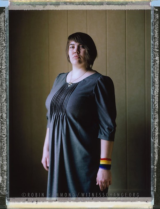 """A posed portrait of 25 year old bisexual Olga Bakhaeva who resigned from her position as a high school history teacher in Magnitogorsk city when the director of the school found out her sexuality. Her director, under pressure from the Education Board, told her not to support LGBT and other groups in opposition to the government. The environment at the school became hostile when Olga continued to be active on social media. She felt humiliated by the director of the school when she outed her in front of other teachers. Privately, afterwards, she was told by the director of the school """"It would be better if you found another job"""". Olga says that the director in fact was not concerned with her sexuality but was worried about the reputation of the school should she not act. In Russia, laws have been made, purportedly, to protect children from LGBT """"propaganda."""" State schools are very pro-government. According to several LGBT teachers, even if there is no law stating LGBT teachers cannot be employed, it is, in reality, not possible to be openly LGBT and a teacher in Russian Government schools or Universities. After Olga resigned her activism increased. Now she is a strong supporter of LGBT non-governmental organization ComingOut SPB and bi-sexual non-governmental organization LuBi. St Petersburg, Russia. November 2014.  While many countries around the world are legally recognizing same-sex relationships, individuals in nearly 80 countries face criminal sanctions for private consensual relations with another adult of the same sex. Violence and discrimination based on sexual orientation or gender expression is even more widespread. Africa is becoming the worst continent for Lesbian, Gay, Bi-sexual, Transgender, Queer, Inter-sex (LGBTQI) individuals. More than two thirds of African countries have laws criminalizing consensual same-sex acts. In some, homosexuality is punishable by death. In Nigeria new homophobic laws introduced in 2013 led to dramatic increase in attacks. Un"""