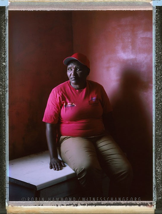 "A posed portrait of Funeka Soldaat, 53, who heads Free Gender, a black lesbian organisation working to end homophobia, based in the township of Khaylitsha, Cape Town. When talking about the formation of the group Funeka says ""We had to fight or die, we didn't have a choice"". Funeka is a survivor of sexual violence targeted because of her sexuality, or, as termed by the media a ""Victim of corrective rape"".  Her attacker was never convicted. She also survived being stabbed in the back multiple times. The attack landed her in intensive care unit: ""when I hear of someone being stabbed, I still feel the pain"". South Africa. November 2014.  While many countries around the world are legally recognizing same-sex relationships, individuals in nearly 80 countries face criminal sanctions for private consensual relations with another adult of the same sex. Violence and discrimination based on sexual orientation or gender expression is even more widespread. Africa is becoming the worst continent for Lesbian, Gay, Bi-sexual, Transgender, Queer, Inter-sex (LGBTQI) individuals. More than two thirds of African countries have laws criminalizing consensual same-sex acts. In some, homosexuality is punishable by death. In Nigeria new homophobic laws introduced in 2013 led to dramatic increase in attacks. Under Sharia Law, homosexuality is punishable by death, up to 50 lashes and six months in prison for woman; for men elsewhere, up to 14 years in prison. Same sex acts are illegal in Uganda. A discriminatory law was passed then struck down and homophobic attacks rose tenfold after the passage of the Anti-Homosexuality Act. In Cameroon it is also illegal. More cases against suspected homosexuals are brought here than any other African country. In stark contrast with the rest of the continent, same sex relationships are legal in South Africa. The country has the most liberal laws toward gays and lesbians on the continent, with a constitution guaranteeing LBGTQI rights. Because of this, LGBTQI Africans from all over the continent fleeing persecution have come to South Africa. Despite these laws, many lesbians have been victims of 'corrective rape' and homosexuals have been murdered for their sexuality. Homophobia is by no means just an African problem. In Russia, politicians spread intolerance. In June 2013 the country passed a law making ""propaganda"" about ""non-traditional sexual relationships"" a crime. Attacks against gays rose. Videos of gay men being tortured have been posted online. In predominantly Muslim Malaysia, law currently provides for whipping and up to a 20-year prison sentence for homosexual acts involving either men or women. Increased extreme Islamification in the Middle East is making life more dangerous for gay men there, as evidenced by ISIS's recent murders of homosexual men. While homophobic discrimination is widespread in Lebanon, life is much safer there than Iran, Iraq, and Syria from which refugees are fleeing due to homophobic persecution. Photo Robin Hammond/Panos for Witness Change"