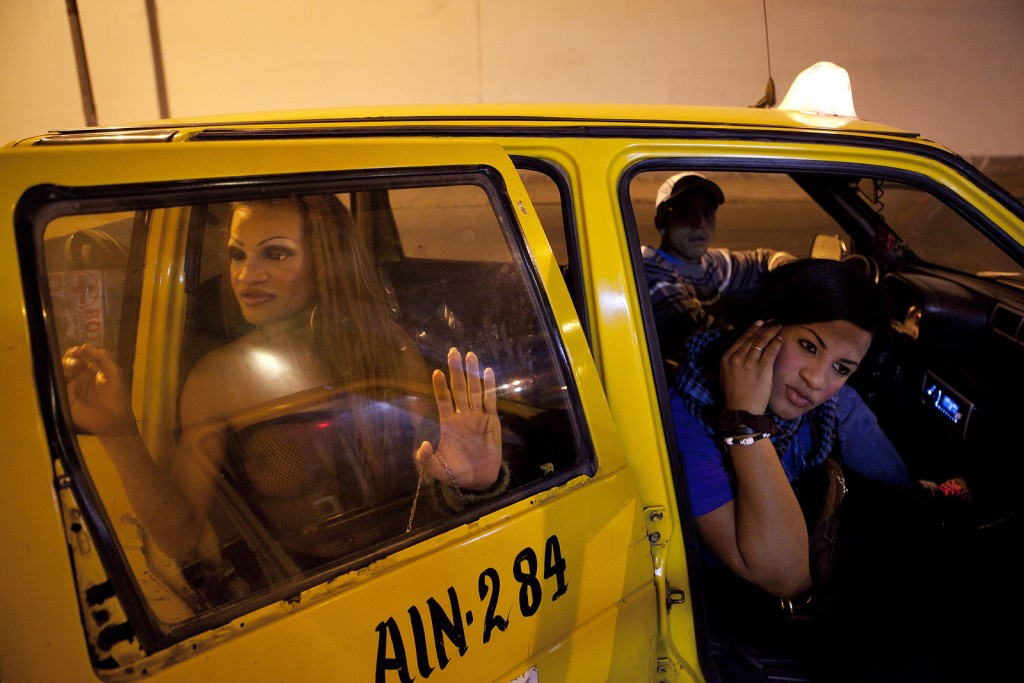 Camila, left, works as both a hairdresser and in sex work. She steps out of a taxi out of a long night of dancing. Because of a transperson's desire to match their body with the way they feel within, many seek to enhance their bodies. However, without hospitals or medical care that attend to transgender people and with limited economic resources, many transwomen inject silicone into their bodies. Camila moved from Brazil to Peru to save money for artificial implantations. Many trans women will buy industrial silicone, which comes from airplane oil and can have extremely harmful long-term consequences such as cancer; thankfully, Camila is very educated on the matter and saved her money for the more expensive silicone. However, a close friend of hers recently died after receiving breast implants.