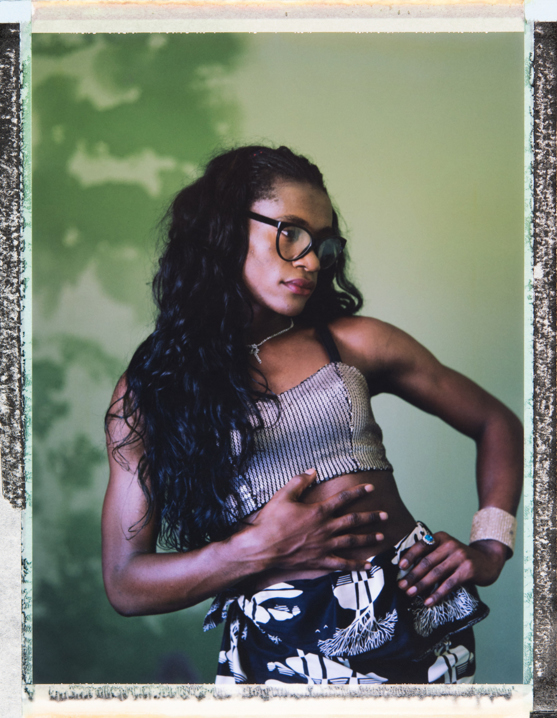 """Tyfane, a transgender woman, talks about growing up: """"I lived my entire childhood listening to offensive words from my parents, friends, classmates, neighbors…"""". Tyfane works as a peer health educator teaching safe sex. She knows that transgender women are in a high risk population for contracting HIV, especially those who do sex work, however, to survive she also has sex for money: """"In order to survive, I would not say that I do sex work. But there are ... certain opportunities which appear that ... take it to an extreme. If I'm broke indeed, I'll do the sex work. But my routine is not about sex work."""" Maputo, Mozambique. 21 February, 2018. Photo Robin Hammond/Witness Change"""