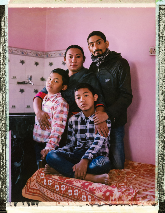 A posed portrait of 36 year-old transgender woman Sunita Thing with her 34 year-old heterosexual husband Shankar Koirala and their sons Sudip Thing, 13, and Dipesh Thing, 10. At 12 years-old Sunita, from a poor rural family, was sent from her village to Kathmandu to be a domestic worker. She knew she was different, and wondered why, but knew no better than to obey her father when, at 17 years-old she was asked to marry a woman. It didnÕt feel right to her though, so much so that she tried to kill herself. Soon her first child was born, and then a second. She had started to become aware of the LGBTQI+ community through Blue Diamond Society, a LGBTI organisation, and realised she was trans. ÒAfter meeting several people like me at Blue Diamond Society, my happiness knew no limit. I started changing on a daily basis.Ó She then met a man. ÒHis name is Shankar and I fell in love with him. We started living together.Ó This brought her into conflict with her wife. ÒI then realized that it was impossible for me and my wife to live together, because we thought differently. We got divorced and went our separate ways. I got my childrenÕs custody.Ó Everything then changed very quickly. ÒI introduced myself as a transgender women and changed my role from their mother to their father. I started counseling them on LGBTI issues from a young age. I started taking them to Blue Diamond SocietyÕs events. My sons have accepted me as their mother and Shankar as their father.Ó Now they present as any other normal family. ÒWe live as husband and wife, like any other couple. We are happy. It has been eleven years.Ò Nepal's current LGBTQI+ laws are some of the most open in the world Ð including the legal recognition of a third gender. Tangible implementation of the various government orders has been piecemeal though, a 2014 United Nations report noted. And government officials have continued to harass LGBT groups, including by alleging that organizing around homosexuality is illegal in the country. Furthermore, while laws are progressive, discrimination is wide spread, especially within families, where marriage between a man and a woman and the bearing of children are expected of young Nepalese. Kathmandu, Nepal. 01.11.18. Photo Robin Hammond/Witness Change