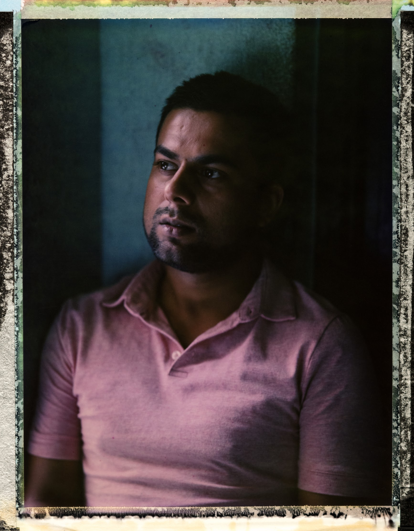"""A posed portrait of 28 year old gay man, LGBT rights activist and 2013 winner of 'Mr Gay Handsom' Bishwaraj Adhikari. """"I lost my friends and family because of my sexuality, because I'm different from others,"""" says Bishwaraj Adhikari of the time when he first came out. He says his family in rural Nepal thought to be gay meant their son was going to transition to be a trans woman. It was too much for them. """"They didn't know about gays and lesbians,"""" he says. """"My Dad said 'if you are going to be like this - you have to leave this family.'"""" Bishwaraj says his life is much better now – """"I'm determined to be happy,"""" he says. He also wants to ply his part in making Nepal an LGBTQI+ friendly country – """"I am determined to fight with this community and to claim rights of LGBT."""" Nepal's current LGBTQI+ laws are some of the most open in the world – including the legal recognition of a third gender. Tangible implementation of the various government orders has been piecemeal though, a 2014 United Nations report noted. And government officials have continued to harass LGBT groups, including by alleging that organizing around homosexuality is illegal in the country. Furthermore, while laws are progressive, discrimination is wide spread, especially within families, where marriage between a man and a woman and the bearing of children are expected of young Nepalese. Katmandu, Nepal. 28 October 2018. Photo Robin Hammond/Witness Change"""
