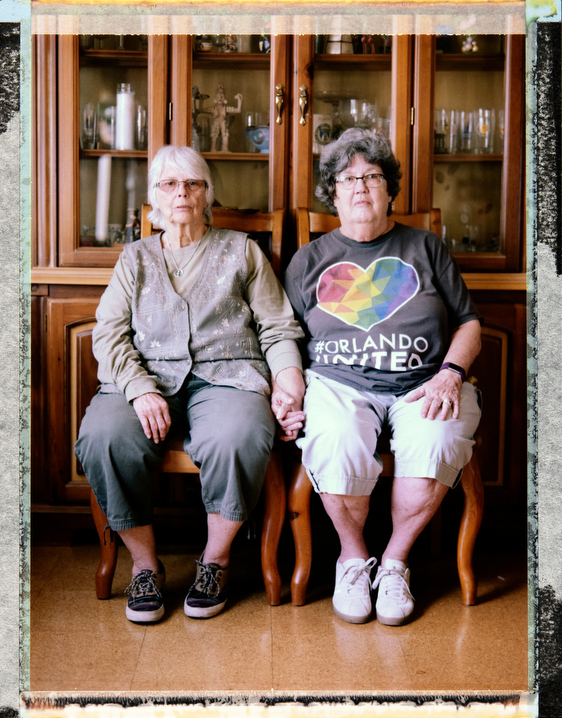 74 year-old, Anglo, bisexual woman Sharon Durrant (right) at home in Orlando with her wife 82 year-old, Anglo Saxon , bisexual woman Ellen Hone (left). Both were previously married to men. They attend First Unitarian Church. Behind the scenes photography and video and assistant: Juan Pablo Ampudia, juanpablo@cuartocreativo.com. Phone +52 1 55 8676 5741. Photography by Robin Hammond, pitures@robinhammond.co.uk. Editor: Mallory Benedict, Mallory.Benedict@natgeo.com, +1 202.791.1282. 24 March 2019
